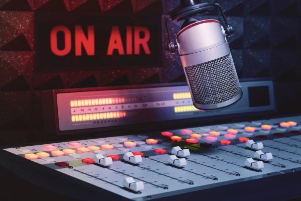 Professional,Microphone,And,Sound,Mixer,In,Radio,Station,Studio